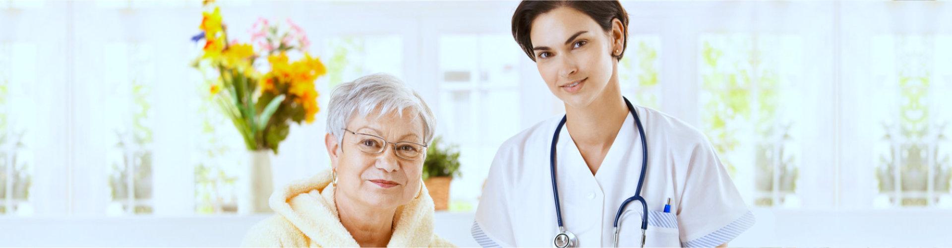 nurse with senior woman smiling